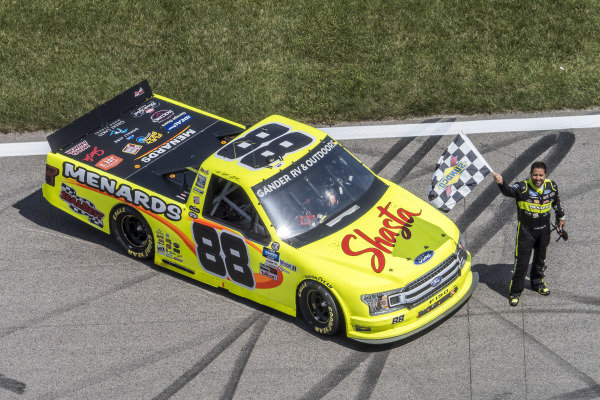 #88: Matt Crafton, ThorSport Racing, Ideal Door/Menards Ford F-150 with the checkered flag