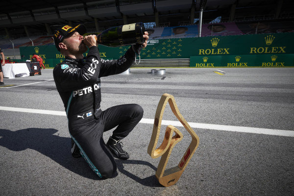 Valtteri Bottas, Mercedes-AMG Petronas F1, celebrates with his trophy and champagne after the race