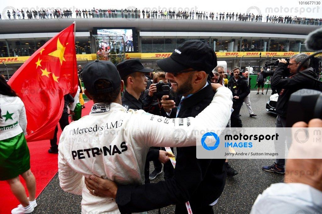 Lewis Hamilton (GBR) Mercedes AMG F1 and Kasseem Dean (USA) Musician (aka Swiss Beatz) on the grid at Formula One World Championship, Rd2, Chinese Grand Prix, Race, Shanghai, China, Sunday 9 April 2017.