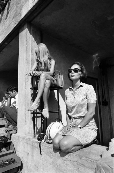 Tish Amon waits for her husband Chris Amon in the Ferrari pits.