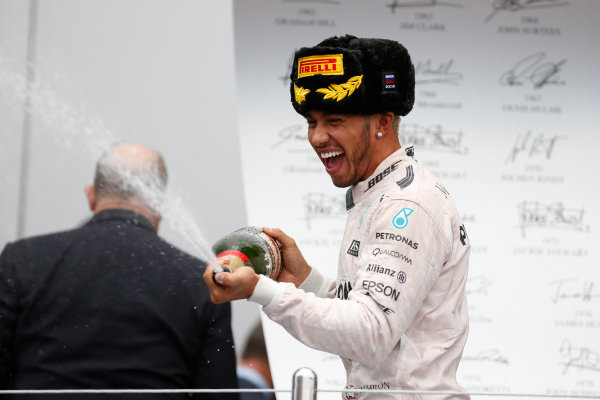Sochi Autodrom, Sochi, Russia. Sunday 11 October 2015. Lewis Hamilton, Mercedes AMG, 1st Position, sprays the victory Champagne. World Copyright: Glenn Dunbar/LAT Photographic ref: Digital Image _89P2864