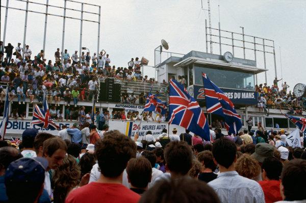 Le Mans, France. 16th - 17th June 1990.  Price Cobb/Martin Brundle/John Neilsen (Jaguar XJR12), 1st position, with team manager Tom Walkinshaw, podium.World Copyright: LAT Photographicref: Colour Transparency.