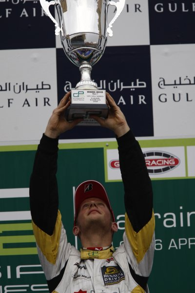 2008 GP2 Asia Series. Saturday Race.Bahrain International Circuit. Sakhir, Bahrain. 5th April. Romain Grosjean (FRA, ART Grand Prix) celebrates victory on the podium. World Copyright: Andrew Ferraro/GP2 Series Media Service. Service ref:__H0Y2658 jpg
