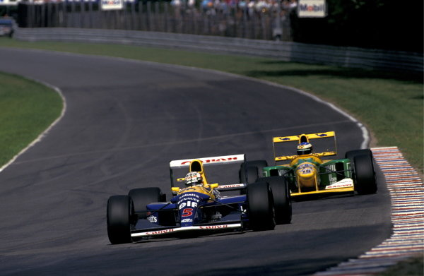 Eventual race winner Nigel Mansell (GBR) Williams FW14B leads Michael Schumacher (GER) Benetton B192 Ford. German Grand Prix, Hockenheim, 26 July 1992. BEST IMAGE
