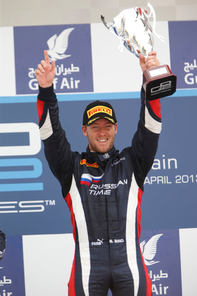 2013 GP2 Series. Round 2.  Bahrain International Circuit, Sakhir, Bahrain. 21st April.  Sunday Race.  Sam Bird (GBR, RUSSIAN TIME) celebrates his victory on the podium.  World Copyright: Glenn Dunbar/GP2 Series Media Service. Ref: _89P4336