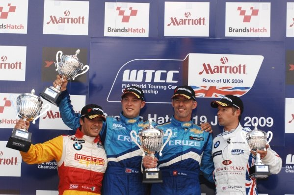 Race 1 podium and results: 1st Alain Menu (SUI), Chevrolet, centre. 2nd Robert Huff (GBR), Chevrolet, left. 3rd Andy Priaulx (GBR), BMW, right. 1st Independent: Stefano D'Aste (ESP), BMW, far left. FIA World Touring Car Championship, Rd8, Brands Hatch, England, 19 July 2009.