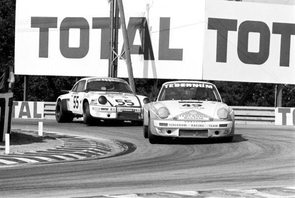 1976 Le Mans 24 hours. Le Mans, France. 12th - 13th June 1976. Clemens Schickentanz / Howden Ganley (Porsche Carrera RSR), retired, leads Christian Poirot / Robert Boubet (Porsche Carrera RSR), 23rd position, action.  World Copyright: LAT Photographic.  Ref:  8778 - 8.