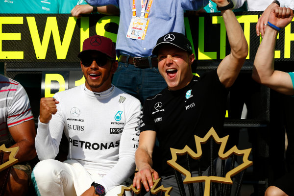 Circuit Gilles Villeneuve, Montreal, Canada. Sunday 11 June 2017. Lewis Hamilton, Mercedes AMG, 1st Position, and Valtteri Bottas, Mercedes AMG, 2nd Position, celebrate with their team. World Copyright: Andrew Hone/LAT Images ref: Digital Image _ONY7234