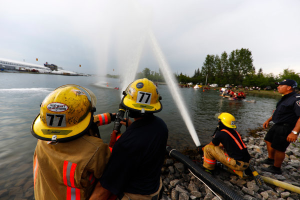 Circuit Gilles Villeneuve, Montreal, Canada. Saturday 10 June 2017. Firefighters aim their hoses at the participants in the raft race. World Copyright: Glenn Dunbar/LAT Images ref: Digital Image _X4I7227