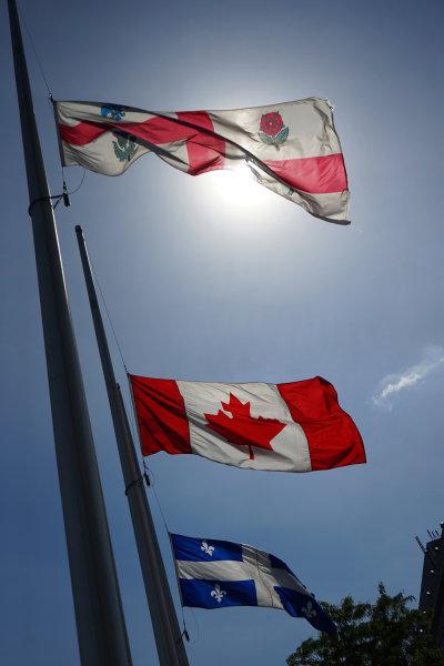Circuit Gilles Villeneuve, Montreal, Canada. Wednesday 3 June 2015. Canadian flags fly World Copyright: Glenn Dunbar/LAT Photographic. ref: Digital Image DSC00472