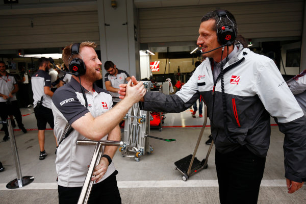Suzuka Circuit, Japan. Saturday 08 October 2016. Guenther Steiner, Team Principal, Haas F1, congratulate a team member after two Haas cars progresses through to Q3. World Copyright: Andy Hone/LAT Photographic ref: Digital Image _ONZ4698