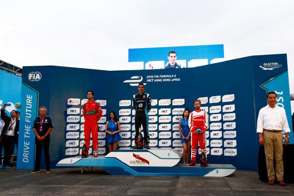2016/2017 FIA Formula E Championship. Hong Kong ePrix, Hong Kong, China. Sunday 09 October 2016. Sebastien Buemi (9, Renault e.dams), Lucas di Grassi (11, ABT Schaeffler Audi Sport) and Nick Heidfeld (23, Mahindra Racing) on the podium. Photo: Zak Mauger/LAT/Formula E ref: Digital Image _L0U2537