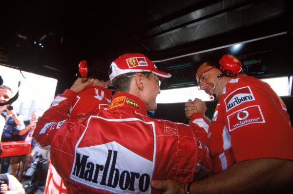 2005 Hungarian Grand Prix. Hungaroring, Hungary. 29th - 31st July 2005 Michael Schumacher, Ferrari F2005 celebrates taking pole with his team. World Copyright: Michael Cooper/LAT Photographic Ref: 35mm Image A30