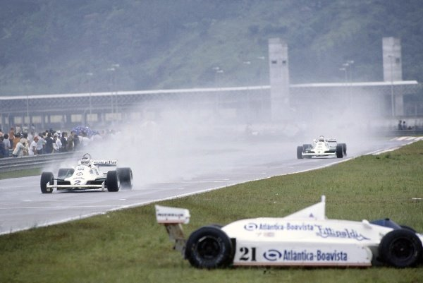 1981 Brazilian Grand Prix.Jacarepagua, Rio de Janeiro, Brazil. 27-29 March 1981.Carlos Reutemann leads Alan Jones (both Williams FW07C-Ford Cosworth) passed the retired Chico Serra (Fittipaldi F8C-Ford Cosworth). Reutemann and Jones finished in 1st and 2nd positions respectively.World Copyright: LAT PhotographicRef: 35mm transparency 81BRA01