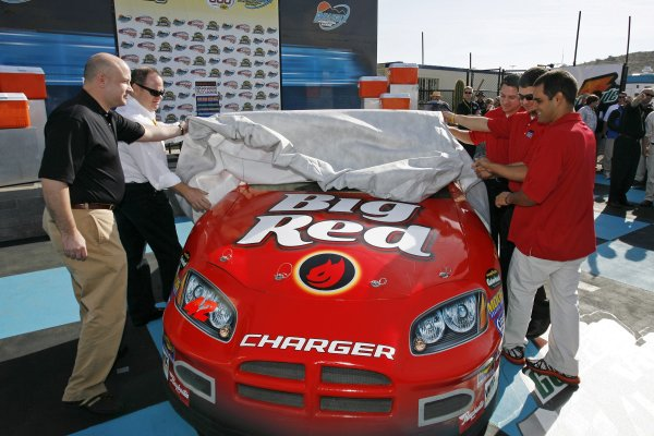 As part of the company's NASCAR debut, Paul Chibe (far left), VP of U S. Marketing for the Wm. Wrigley Jr. Company is joined by Chip Ganassi in revealing the No. 42 Big Red Dodge, which will be driven by Juan Pablo Montoya (far right) in three NEXTEL Cup races next season.  Montoya's teammates David Stremme and Reed Sorenson (middle, right side) will pilot the No. 41 Dodge in 25 Busch Series races, which will feature a rotation of Wrigley's Spearmint, Doublemint, Juicy Fruit and Winterfresh brands.