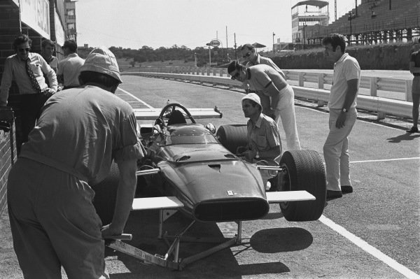 1970 South African Grand Prix. Kyalami, South Africa. 5th - 7th March 1970. AMechanic work on a Ferrari 312B in the pits as Jo Siffert looks on, action.  World Copyright: LAT Photographic. Ref: 2891 - 12.