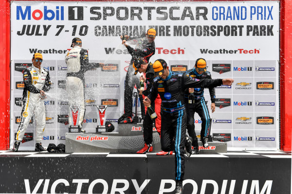 7-10 July 2016, Bowmanville, Ontario Canada Prototype winners podium 31, Chevrolet, Corvette DP, P, Eric Curran, Dane Cameron, 10, Chevrolet, Corvette DP, P, Ricky Taylor, Jordan Taylor, 5, Chevrolet, Corvette DP, P, Joao Barbosa, Christian Fittipaldi, celebrate with champagne  ?2016, Scott R LePage  LAT Photo USA