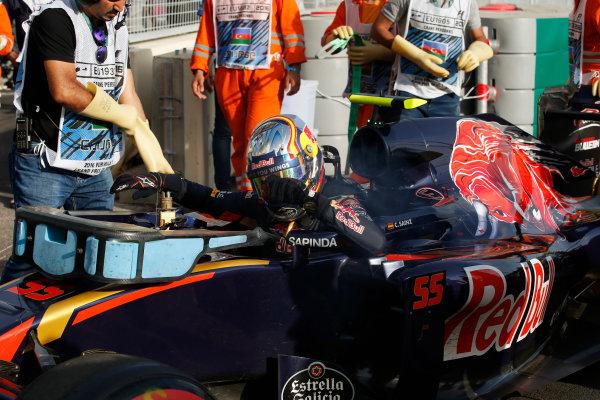Baku City Circuit, Baku, Azerbaijan. Sunday 19 June 2016. Carlos Sainz Jr, Toro Rosso, retires from the race. World Copyright: Glenn Dunbar/LAT Photographic ref: Digital Image _W2Q9384