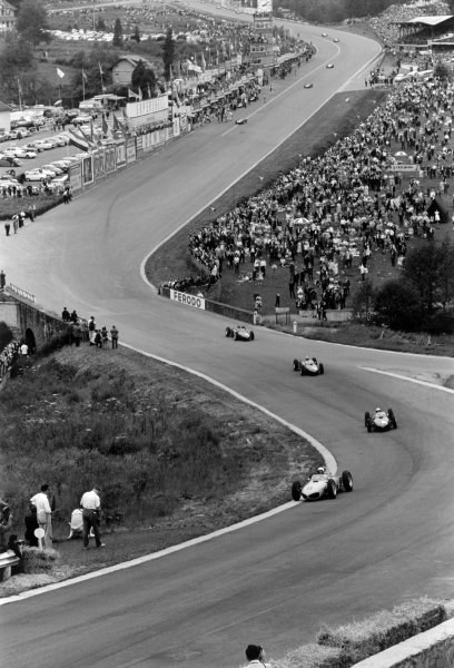 1961 Belgian Grand Prix Spa-Francorchamps, Belgium. 16-18 June 1961 Olivier Gendebien leads Phil Hill, Wolfgang von Trips and Richie Ginther (all Ferrari 156) through Eau Rouge. They finished in 4th, 1st, 2nd and 3rd position respectively - a 1-2-3-4 for the marque World Copyright: LAT PhotographicRef: Autosport b&w print