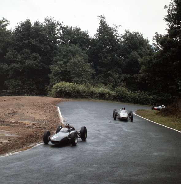 Nurburgring, Germany. 3-5 August 1962.  Graham Hill (BRM P57) leads Dan Gurney (Porsche 804) at Adenauer-Forst. They finished in 1st and 3rd positions respectively.  Ref-3/0617. World Copyright - LAT Photographic