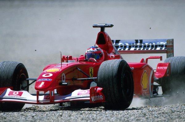 Rubens Barrichello (BRA) Ferrari F2002 takes a trip into the gravel trap. Austrian Grand Prix, Rd6, A1-Ring, Austria. 13 May 2002. BEST IMAGE