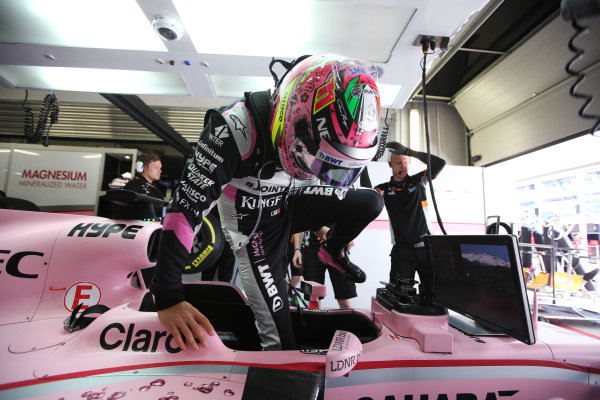 Sochi Autodrom, Sochi, Russia. Friday 28 April 2017. Sergio Perez, Force India, enters his cockpit in the garage. World Copyright: Charles Coates/LAT Images ref: Digital Image AN7T9803