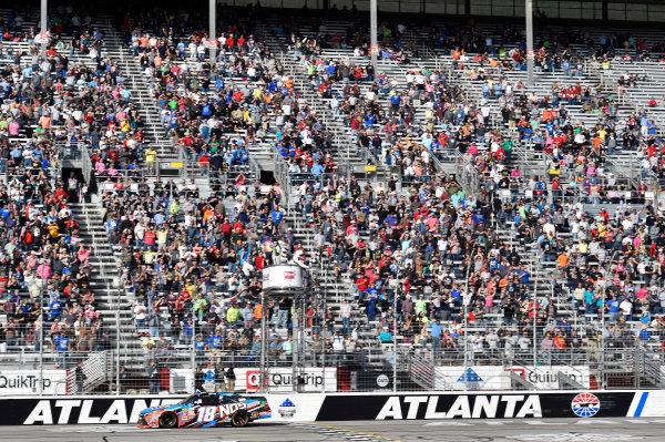 2017 NASCAR XFINITY Series - Rinnai 250 Atlanta Motor Speedway, Hampton, GA USA Saturday 4 March 2017 Kyle Busch, NOS Energy Drink Toyota Camry takes the checkered flag and the win World Copyright: Nigel Kinrade/LAT Images ref: Digital Image 17ATL1nk05761