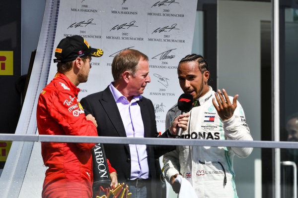 Sebastian Vettel, Ferrari and Lewis Hamilton, Mercedes AMG F1 talk to Martin Brundle, Sky TV on the podium