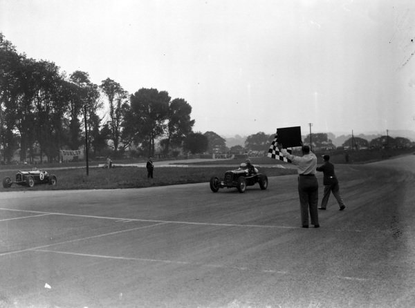 Arthur Dobson, ERA-C, crosses the line and takes the chequered flag.