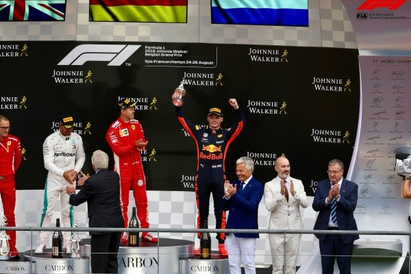 Max Verstappen, Red Bull Racing celebrates on the trophy with his trophy with Sebastian Vettel, Ferrari and Lewis Hamilton, Mercedes AMG F1