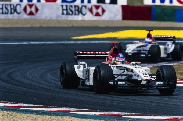 Jacques Villeneuve, BAR 005 Honda, leads Jenson Button, BAR 005 Honda.