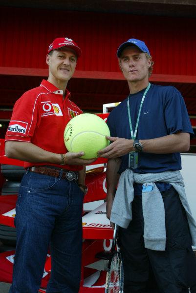 2002 Spanish Grand Prix.Catalunya, Barcelona, Spain. 26-28 April 2002.Michael Schumacher and Australian tennis ace Leyton Hewitt.World Copyright - LAT Photographicref: digital image only