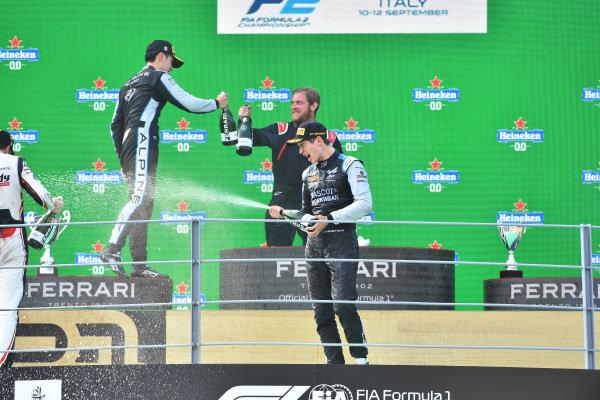 Christian Lundgaard (DNK, ART Grand Prix), 3rd position, sprays champagne on the podium