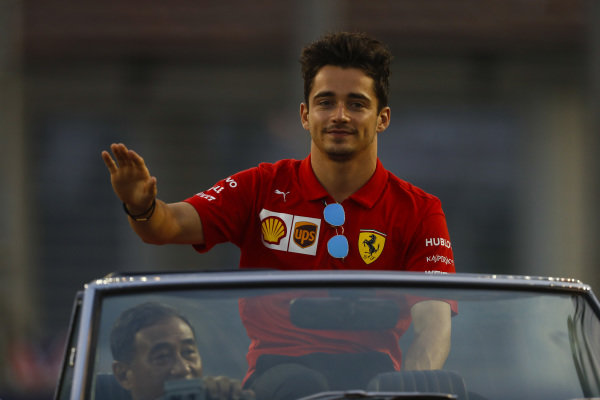 Charles Leclerc, Ferrari, rides in an Alfa Romeo on the drivers' parade