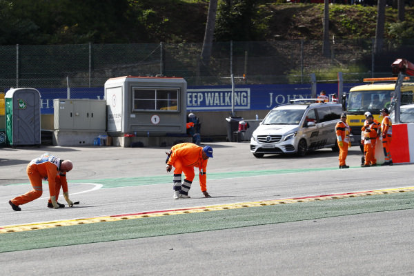 Marshals pick up debris from contact between Max Verstappen, Red Bull Racing RB15 and Kimi Raikkonen, Alfa Romeo Racing C38