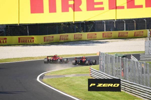 Alexander Albon, Red Bull Racing RB16, battles with Charles Leclerc, Ferrari SF1000