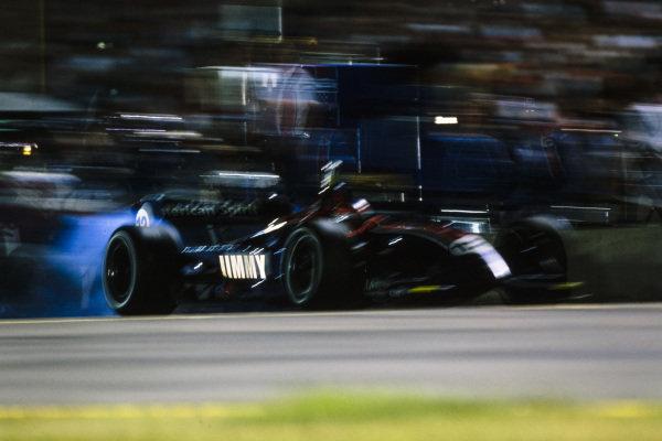 Jimmy Vasser, American Spirit Team Johansson, Reynard 02I, gets wheelspin following a pitstop.