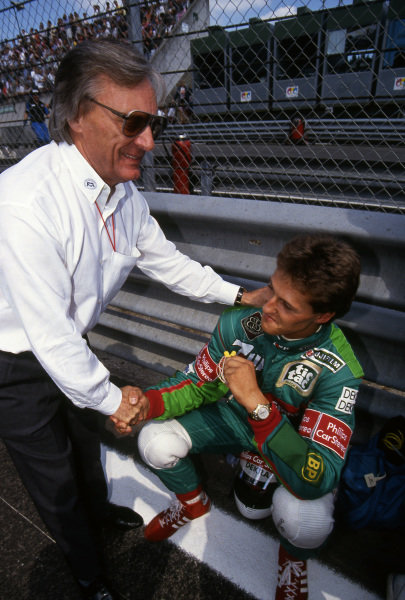 Bernie Ecclestone, F1 Supremo, welcomes Michael Schumacher, Jordan, to F1 for his first race.Formula One World Championship, Rd11, Belgian Grand Prix, Spa, 25 August 1991.