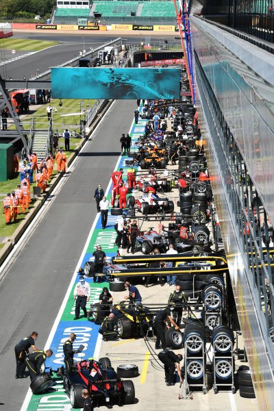 The F2 teams prepare their cars for the start of their race. Guanyu Zhou (CHN, UNI-VIRTUOSI) and Callum Ilott (GBR, UNI-VIRTUOSI) are in the foreground