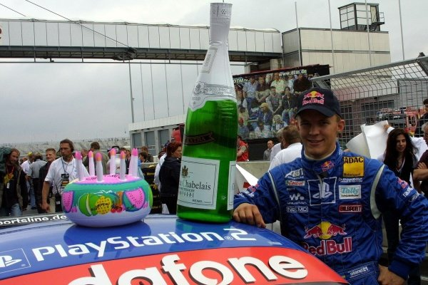 Red Bull driver Mattias Elkstrom (SWE) celebrated his birthday.DTM Championship, Rd6, Lausitzring, Germany. 14 July 2002.DIGITAL IMAGE