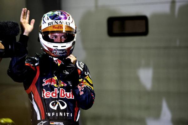 Marina Bay Circuit, Singapore.24th September 2011.Sebastian Vettel, Red Bull Racing RB7 Renault, celebrates pole. Portrait. Helmets. World Copyright: Andy Hone/LAT Photographicref: Digital Image CSP28549