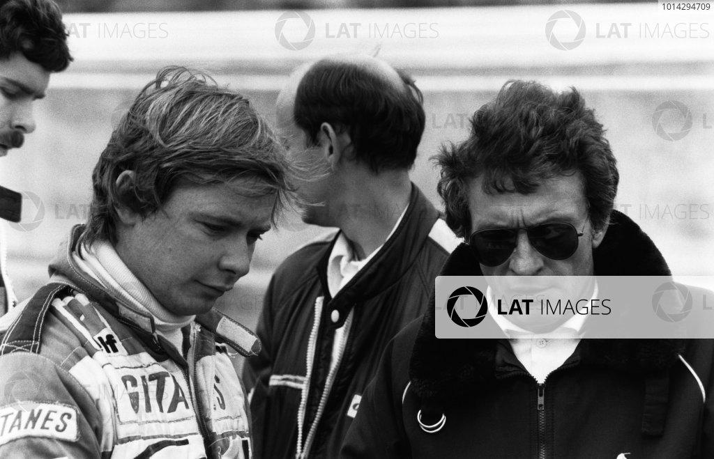 1980 British Grand Prix. Brands Hatch, Great Britain. 11-13 July 1980. Didier Pironi (Ligier JS11/15-Cosworth), retired, talks to designer, Gerard Ducarouge, portrait.  World Copyright: LAT Photographic.  Ref:  B/W Print.