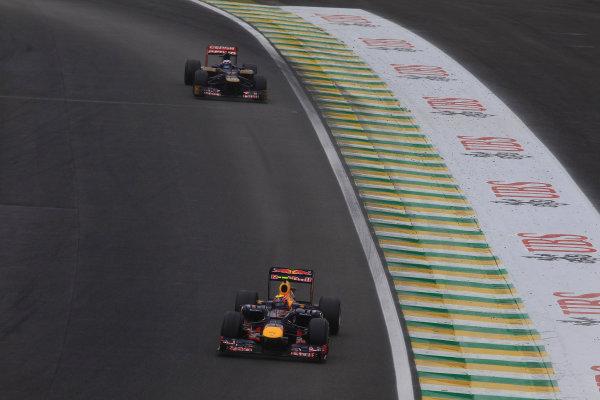 Interlagos, Sao Paulo, Brazil. Sunday 25th November 2012. Mark Webber, Red Bull RB8 Renault, leads Daniel Ricciardo, Toro Rosso STR7 Ferrari.  World Copyright:Charles Coates/LAT Photographic ref: Digital Image _X5J7945