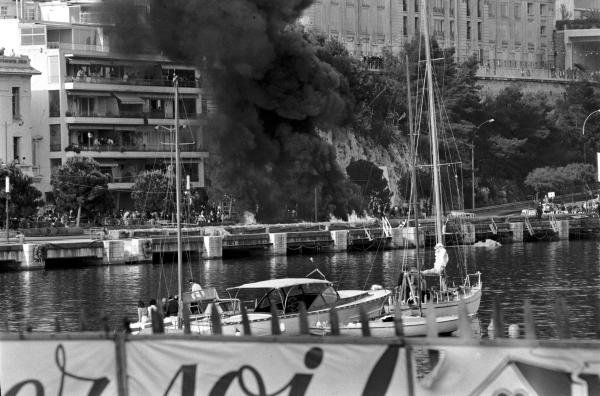 Smoke billows from the wreckage of Lorenzo Bandini's (ITA) Ferrari 312. Tragically he would die from his injuries.  Monaco Grand Prix, Monte Carlo, 7  May 1967