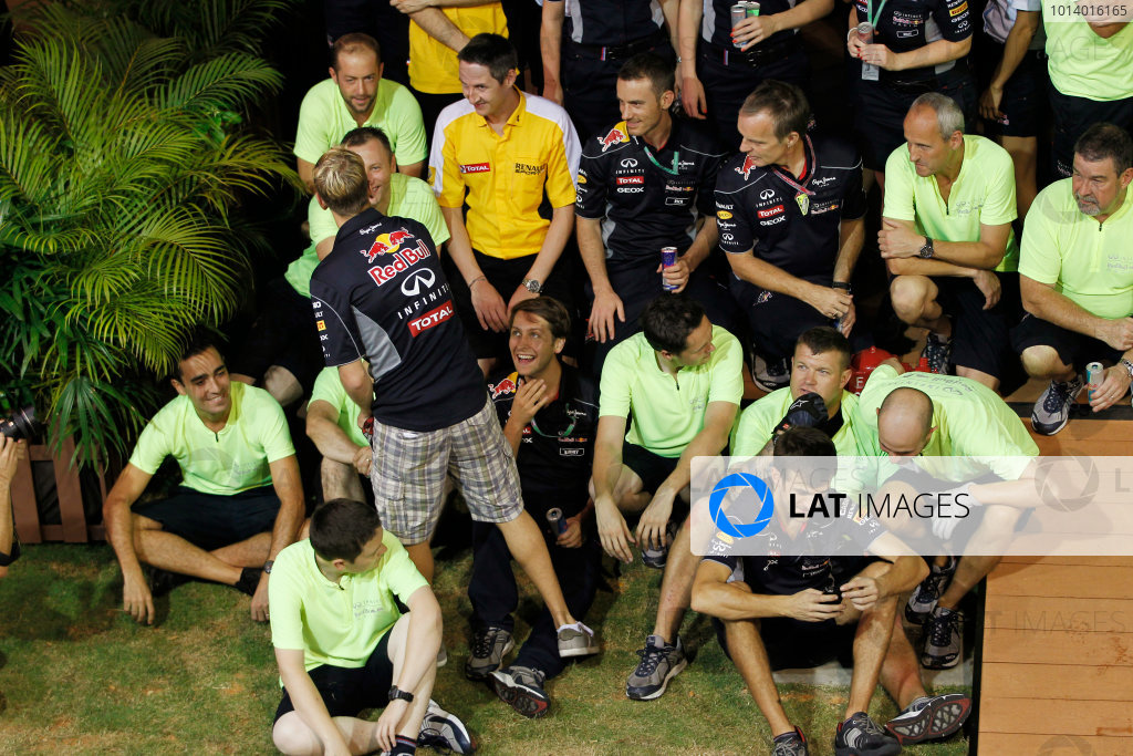 Marina Bay Circuit, Singapore. Sunday 22nd September 2013.  Sebastian Vettel during the Red Bull Racing celebration team photo.  World Copyright: Jed Leicester/LAT Photographic. ref: Digital Image _JEL3273