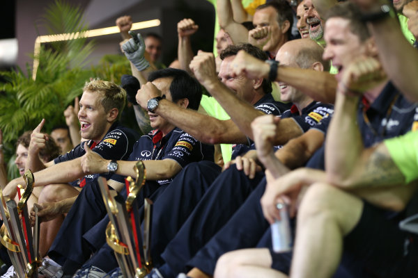 Marina Bay Circuit, Singapore. Sunday 22nd September 2013.  Sebastian Vettel in the Red Bull Racing team celebration photo.  World Copyright: Andy Hone/LAT Photographic. ref: Digital Image HONZ6157