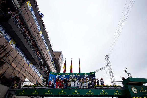 2015 Le Mans 24 Hours. Circuit de la Sarthe, Le Mans, France. Sunday 14 June 2015. Podium. 1st, Porsche Team (Porsche 919 Hybrid - LMP1), Nico Hulkenberg, Earl Bamber, Nick Tandy, 2nd, Porsche Team (Porsche 919 Hybrid - LMP1), Timo Bernhard, Mark Webber, Brendon Hartley, and 3rd, Audi Sport Team Joest (Audi R18 E-Tron Quattro - LMP1), Marcel Fassler, Andre Lotterer, Benoit Treluyer. World Copyright: Zak Mauger/LAT Photographic. ref: Digital Image _L0U6139