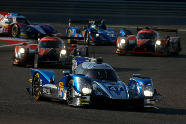2015 FIA World Endurance Championship Bahrain 6-Hours Bahrain International Circuit, Bahrain Saturday 21 November 2015. Matthew Howson, Richard Bradley, Nick Tandy (#47 LMP2 KCMG Oreca 05 Nissan) leads Roman Rusinov, Julien Canal, Sam Bird (#26 LMP2 G-Drive Racing Ligier JS P2 Nissan), Gustavo Yacaman, Luis Felipe Derani, Ricardo Gonzalez (#28 LMP2 G-Drive Racing Ligier JS P2 Nissan), Nelson Panciatici, Paul Loup Chatin, Tom Dillmann (#36 LMP2 Signatech Alpine Alpine A450B Nissan) and Mikhail Aleshin, Nicolas Minassian, David Markozov (#44 LMP2 AF Racing BR01 Nissan). World Copyright: Alastair Staley/LAT Photographic ref: Digital Image _79P0155