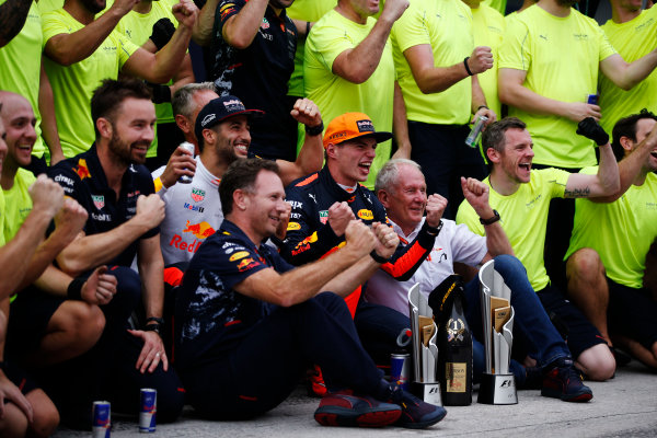 Sepang International Circuit, Sepang, Malaysia. Sunday 01 October 2017. Max Verstappen, Red Bull, 1st Position, and Daniel Ricciardo, Red Bull Racing, 3rd Position, celebrate with Helmut Markko, Consultant, Red Bull Racing, Christian Horner, Team Principal, Red Bull Racing, and the Red Bull team. World Copyright: Zak Mauger/LAT Images  ref: Digital Image _X0W9281