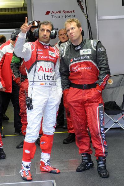 Circuit de La Sarthe, Le Mans, France. 13th - 17th June 2012. RaceMarc Gene, Audi Sport Team Joest, No 3 Audi R18 Ultra, talks with a mechanic.Photo: Jeff Bloxham/LAT Photographic. ref: Digital Image DSC_4843